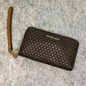 Michael Kors | brown leather perforated wristlet